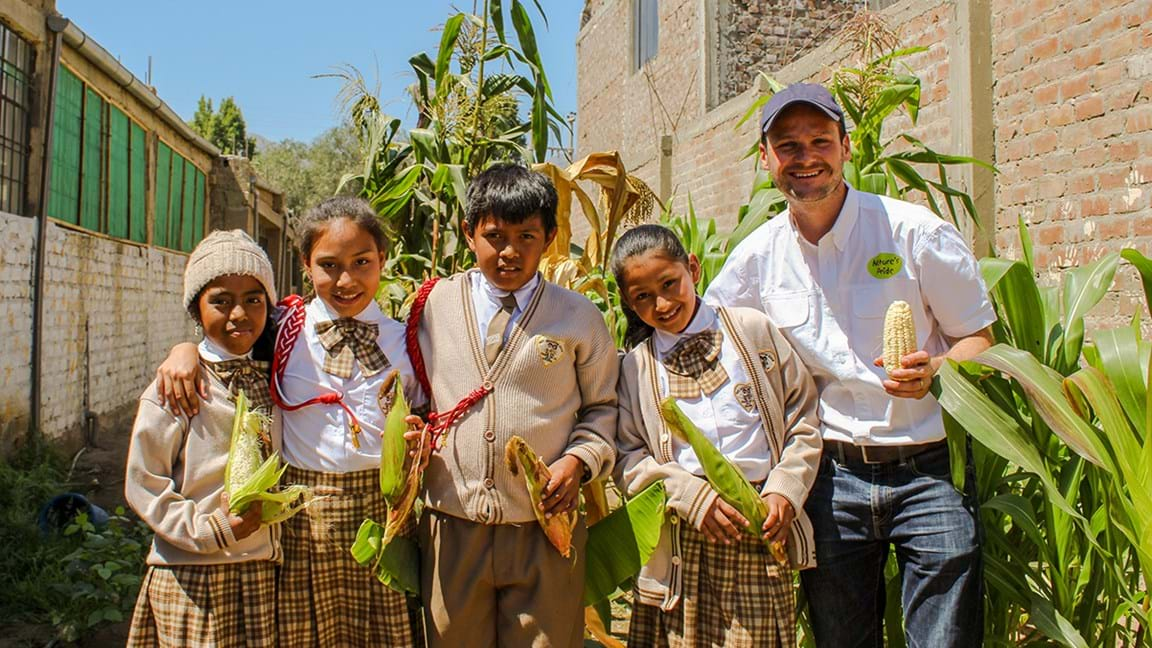 Peruvian Children Harvesting A Healthy  Lunch Nature's Pride